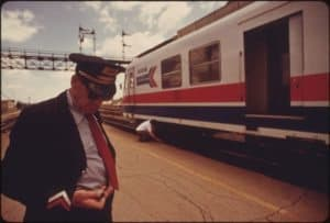 Conductor Checks his Time for Train